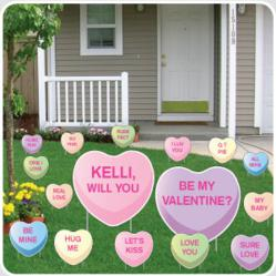 Yard Cards for Valentine's Day in the shape of candy hearts.