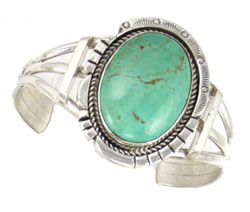This handmade sterling silver cuff bracelet features a beautiful oval turquoise stone, and is available at BillyTheTree.com.