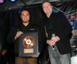 Jay Baldemor, President of Gruv Gear, accepts the award plaque from NAMM