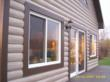 Vinyl log siding gives any home character whether it's in the suburbs or tucked away in the woods.