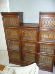 """These absolutely beautiful Barrister Bookcases are a unique and striking antique made from Globe-Wernicke Leaded Glass and Sawn Oak. They are compiled of stacking ¼ bookcases in excellent condition! This beautiful piece measures 17""""L x 11""""W x 59.5""""H."""