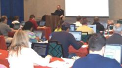 John Alexander speaking to students on Keyword Forensics research