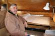 General contractor, Richard Nash, inside his onsight jobsite trailer - a vintage 1961 Shasta.