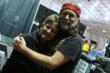 Sue Arko, who brought BransonFest Out West to Mesquite, is hugged by Willie Nelson impersonator Clint Ingbretson.