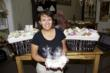 Organic Soap and Spa Owner Joan Saez with gift baskets headed to The Denver Broncos