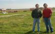 Michael and Mark Fruge standing on the farm.