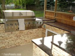 Stone veneer paneling covers a built-in grill and serving area