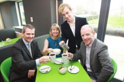 The DCS Managermernt Team Toast Their Success at Cafe Meos