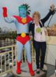 Captain Planet and Barbara Pyle demonstrate first-hand that 'by our powers combined' we can look forward to more clear and sunny days on this beautiful Earth.