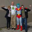 Atlanta film producers Barbara Pyle and Kyle King flank actor-environmentalist Ed Begley Jr. and Captain Planet during a party at Bruno's in Santa Monica.