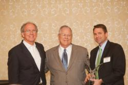 Owners' Counsel of America attorneys Joe Waldo and Andrew Brigham present Miami-based eminent domain lawyer, Toby Prince Brigham, with the Crystal Eagle Award for his dedication to private property rights.