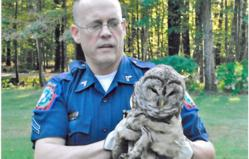 Jason Fiske with Barred Owl