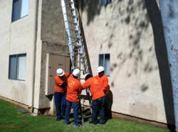 Course Participants learn about ladder safety and set-up.