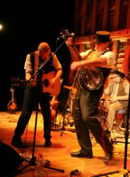Simon Middleton, founder of UK's leading banjo retailer, Banjos Direct, performing with his band The Proposition, featuring Nigel Orme on 6-string banjo.