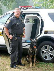 Officer and Canine Partner with Havis' Award-winning 2011 Ford Explorer K9 Transport System