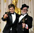 William Joyce (R) and Brandon Oldenburg, winners of the Animated Short Film Award for 'The Fantastic Flying Books of Mr. Morris Lessmore' pose in the press room at the 84th Annual Academy Awards at th