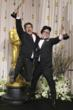 """Brandon Oldenburg, left, and William Joyce, jump with their awards for best animated short film for """"The Fantastic Flying Books of Mr. Morris Lessmore"""" during the 84th Academy Awards on Sunday, Feb. 2"""