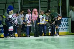 Pink in the Rink Guests of Honor Drop Ceremonial Fist Pucks (Photo by Dave Griffioen)