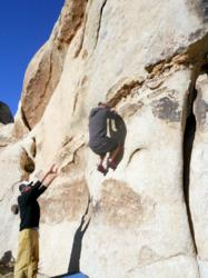Faus assisting Back2Basics resident during rock climbing trip at Joshua Tree National Park.