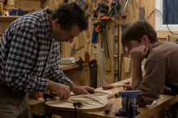 Luthier Jay Lichty with acoustic guitar building workshop student