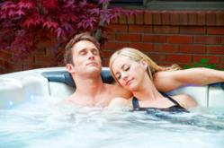 Couple relaxing in a hot tub by Bullfrog Spas