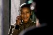 Ofentse Rosina Phiri, 21 years old, uses her mobile phone outside Alexandra township, Gauteng Province, South Africa. Credit: Wayne Conradie
