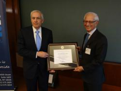 AIPR President Fred Schwartz presents the Raphael Lemkin Genocide Prevention Prize to Gen. Wesley Clark