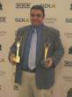 L-com's Customer Service Supervisor Chris Cote with Awards