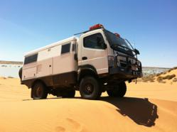 EarthCruiser driving through the sand
