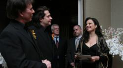 Fran Drescher, an ordained minister, officiating at the wedding of John Blair, left, and Beto Sutter at the Out NYC in New York.