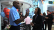Carl Lewis and IFV News' Marcella Palmer