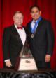 Bob Felix from Straub Construction, Inc. accepts the ABC Pyramid Award from Michael D. Bellaman, ABC president and CEO.