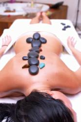 getting a hot stone treatment at a local day spa