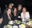 Melissa White and her Archetype Inc team pose for a picture at their table