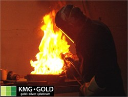 Pouring a gold bar from molten scrap gold