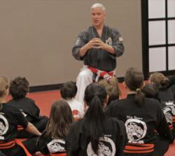 Sensei Storms teaching a group of students about Street Smarts