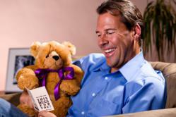Man Holding Teddy Bear Teddy Gram. The ideal feel better gift.