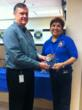 Leon Ewing, President/CEO of Firstmark Credit Union and Linda Sue Rodriguez, Assistant Vice President of the Member Contact Center celebrate receiving a 2012 BenchmarkPortal Top 100 Award.