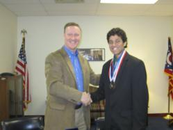 Dwight Global Leadership Academy graduate Nielsen Dias receives Congressional Medal for Service from Congressman Steve Stivers.