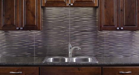 Waves in Brushed NickelThe Waves backsplash features undulating patterns  that convey movement and rhythm in a sleek, contemporary design