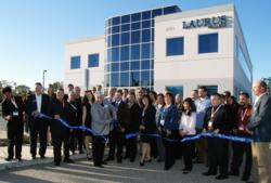 Community Leaders Watch as Campus President Tony Amato Cuts Ribbon in Front of Laurus College's Oxnard Campus