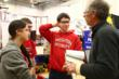 Students consult with Coach Steve Compton