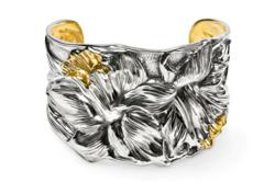 The iris is celebrated in this extraordinary repousse' sterling cuff