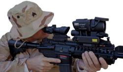 The FLIR Systems Inc. T60 Clip on thermal weapon sight mounted on an AR15 platform with the Trijicon ACOG 4x32 Day scope