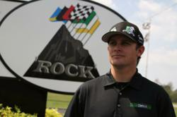 "Justin Lofton, Driver and Spokesperson for CollegeComplete.com stands at the enry to ""The Rock"" and promotes Free Education Advice proveded by College Complete at 877-543-2655"