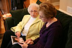 senior looking at family photos
