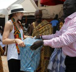 Katharine McPhee receives a gift during her visit to Ghana