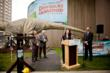 Rita Ortiz, Travelers Community Relations addresses the crowd at the Dinosaurs Unearthed opening ceremony.