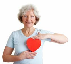 Senior in Oak Park holding a heart