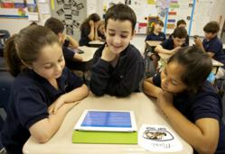 Fourth-graders at Beth Emet Elementary School in Cooper City, Fl. read Brush of Truth, a book app.